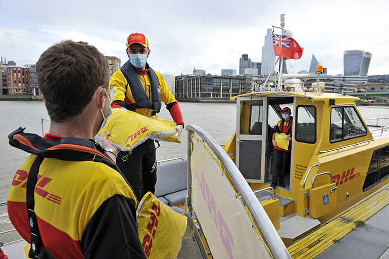 DHL Express riverboat parcel handover.JPG